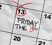 Calendar with Friday the thirteenth date circled in red
